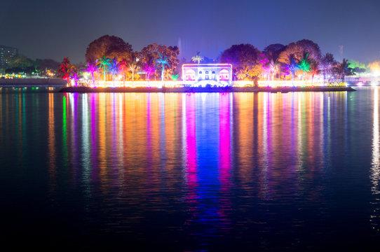 Beautiful and colorful lights reflected in the water of kankaria lake ahmedabad, gujarat