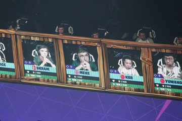 Contestants look at screens during the Fortnite World Cup Duos Finals at Flushing Meadows Arthur Ashe stadium in the Queens borough of New York