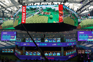 Contestants compete during the Fortnite World Cup Duos Finals at Flushing Meadows Arthur Ashe stadium in the Queens borough of New York