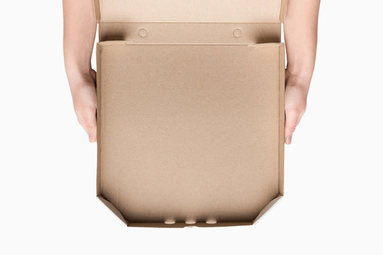 Woman's hands holding empty pizza box, top view