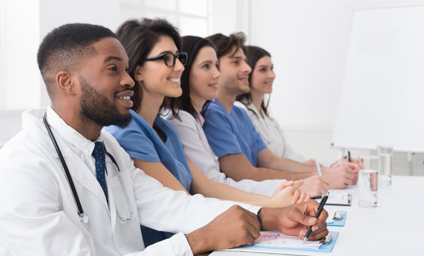 Medical lecture. Doctors and interns listening to professor