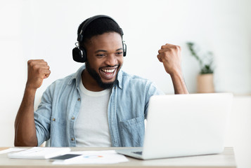 African American male freelancer celebrating completing the project