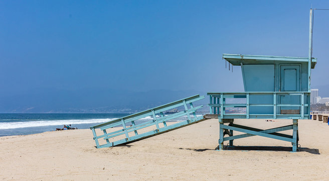 Lifeguard hut on Santa Monica beach. Pacific ocean coastline Los Angeles USA.