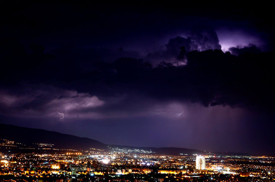 A lightning lights up the sky, in Skopje