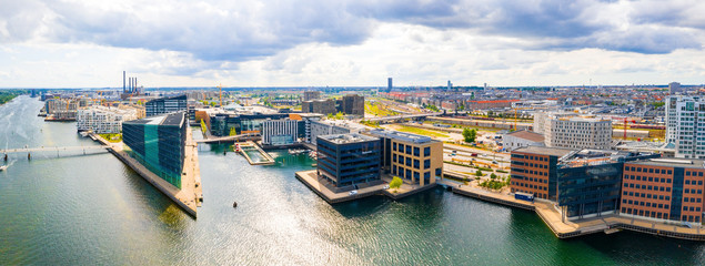 Fototapete - Beautiful aerial view of the new modern district in Copenhagen, with glass skyscrapers, office buildings and modern architecture.