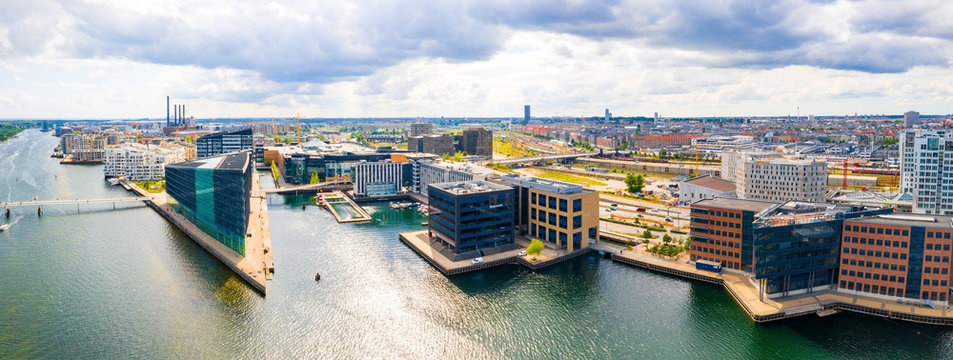 Beautiful aerial view of the new modern district in Copenhagen, with glass skyscrapers, office buildings and modern architecture.