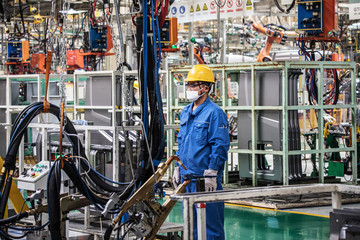 Workers in machinery factory in China.