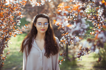Woman Outdoors in Park Near Spring Blossom Tree