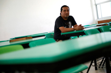 Miguel Arcos, 43, teacher, speaker of the  Ch'ol language, poses for a photo at a school in Mexico City