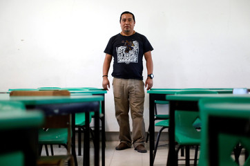 Miguel Arcos, 43, teacher, speaker of the Ch'ol language, poses for a photo at his school in Mexico City