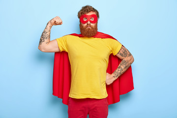 Self confident superhero shows biceps, fights evil and helps people, has great actions and achievements, pretends being heroic character, possesses supernatural power, wears mask and red cape