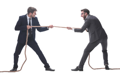 full length . two smiling businessmen pulling the rope.