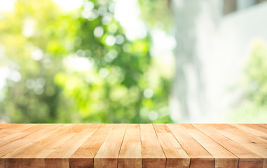 Empty wood table top on blur abstract green from garden and home area background