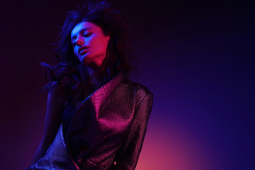 High fashion girl model in stylish clothing in color neon light