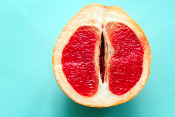 top view ripe juicy grapefruit  isolated on a blue background Wall mural