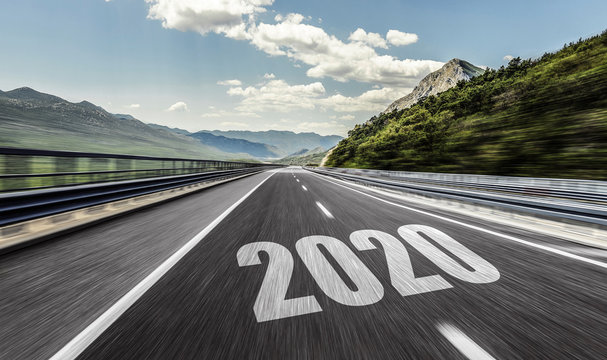 2020 New Year inscription on the asphalt highway. Two thousand and twenty.