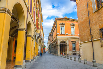 Typical italian street, buildings with columns, Palazzo Paleotti, Palazzo Gotti palace, Since Academy, University of Bologna in old historical city centre of Bologna, Emilia-Romagna, Italy