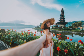 Fotorolgordijn Bali Couple spending time at the ulun datu bratan temple in Bali. Concept about exotic lifestyle wanderlust traveling