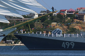 Russian sailors line up onboard a warship during the Navy Day parade in the Black Sea port of Sevastopol