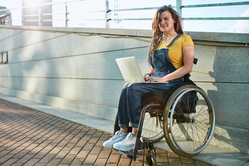 pleasant young woman conducting online consultations, giving reccomendations for customers, working with clients online. full length photo. copy space