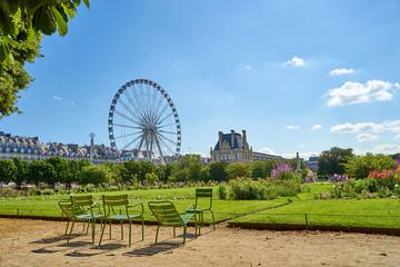 """Famous Park """"Jardin des Tuileries"""" with Ferris Wheel next to Louvre Museum"""