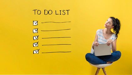 To do list with young woman using a laptop computer