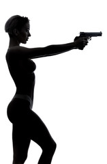 serious confident girl in stylish underwear going to shooting a gun, aiming for boyfrind,a sniper scope. close up side view photo. studio shot