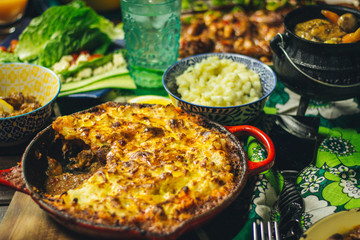 Chicken Liver Cottage Pie with Samp and Salad on Wooden Deck