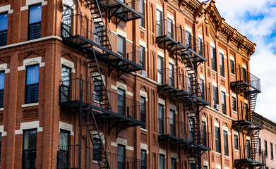 Red Fire escape stairs-downtown back alley architecture-steel and red brick background