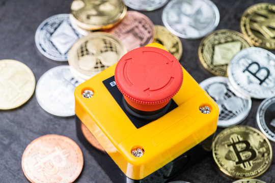 Bitcoin and crypto currency price stop loss or cut loss concept, big red pushing emergency stop button on various cryptocurrencies physical coins, crypto crisis protection when market price fall