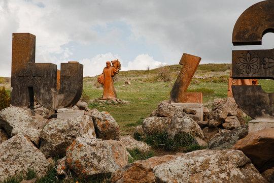 Aparan, Armenia, may 11, 2019: Armenian alphabet Museum on a rocky slope in Armenia