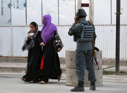 Women leave the site of a powerful blast in Kabul