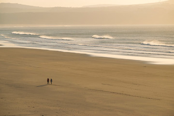 Couple Walkin On a Sunset Beach in Cornwall
