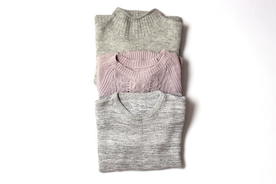 sweaters on a white background top view