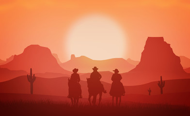 Cowboys riding horses at sunset - Western and Wild West concept