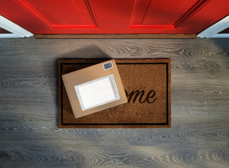 Delivered outside door, e-commerce purchase on welcome mat. Add your own copy and label