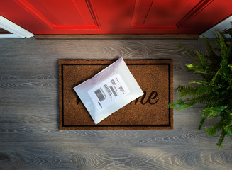 Padded envelope delivered outside door. Overhead view.