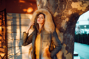 Autumn season. Gorgeous pretty woman in furry coat jacket stand urban background. Trendy outfit. Her confidence is stunning. Woman enjoy sunny day outdoors. Fall season outfit. Modern fashion outfit Wall mural
