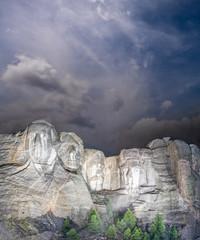 Fototapete - Mt. Rushmore national memorial park in South Dakota at night, presidents faces illuminated against black sky