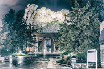 Fotomurales - Mount Rushmore entrance at night from the avenue of flags, South Dakota