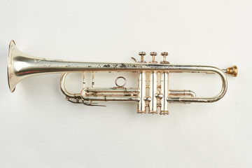 Rusty trumpet on white background. Old classical trumpet. Vintage musical instrument.