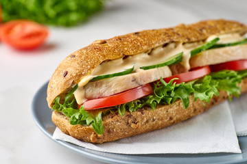 Photo on textile frame Snack Big sandwich with chicken and vegetables on dish