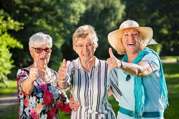 Three positive elderly women.