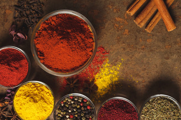 Printed kitchen splashbacks Spices Red Ground Paprika. Place for text. Different types of Spices in a bowl on a stone background. The view from the top
