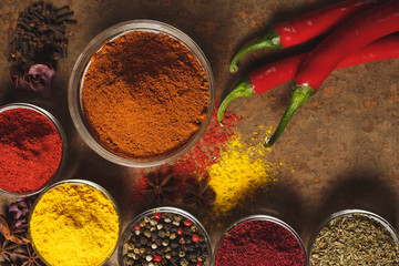Red hot chili peppers. Place for text. Different types of Spices in a bowl on a stone background. The view from the top