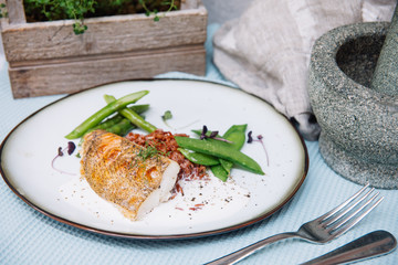 Halibut white fish in coconut sauce with ruby rice and blanched asparagus