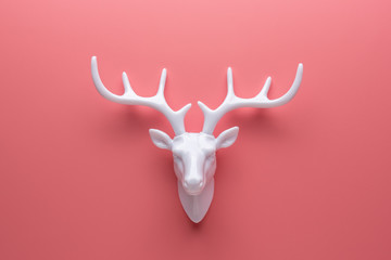 White reindeer with white antlers. Minimal New Year or Christmas background concept.