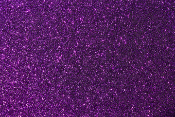 Dark purple color glitter texture background with vibrant color