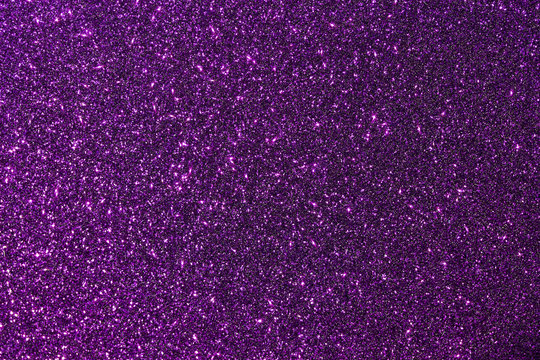 Dark purple color glitter texture background with vibrant color