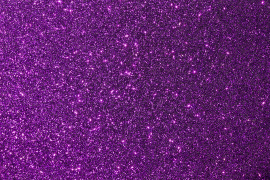 Dark purple color shiny glitter texture background with vibrant color
